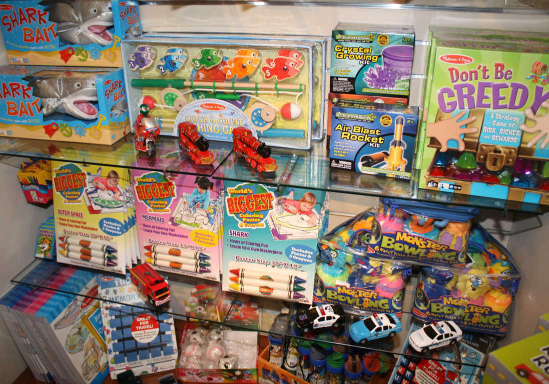 An Abundance of Children's Toys such as Fishing Game, Trucks and Crayons Available at Mon General Gift Shop