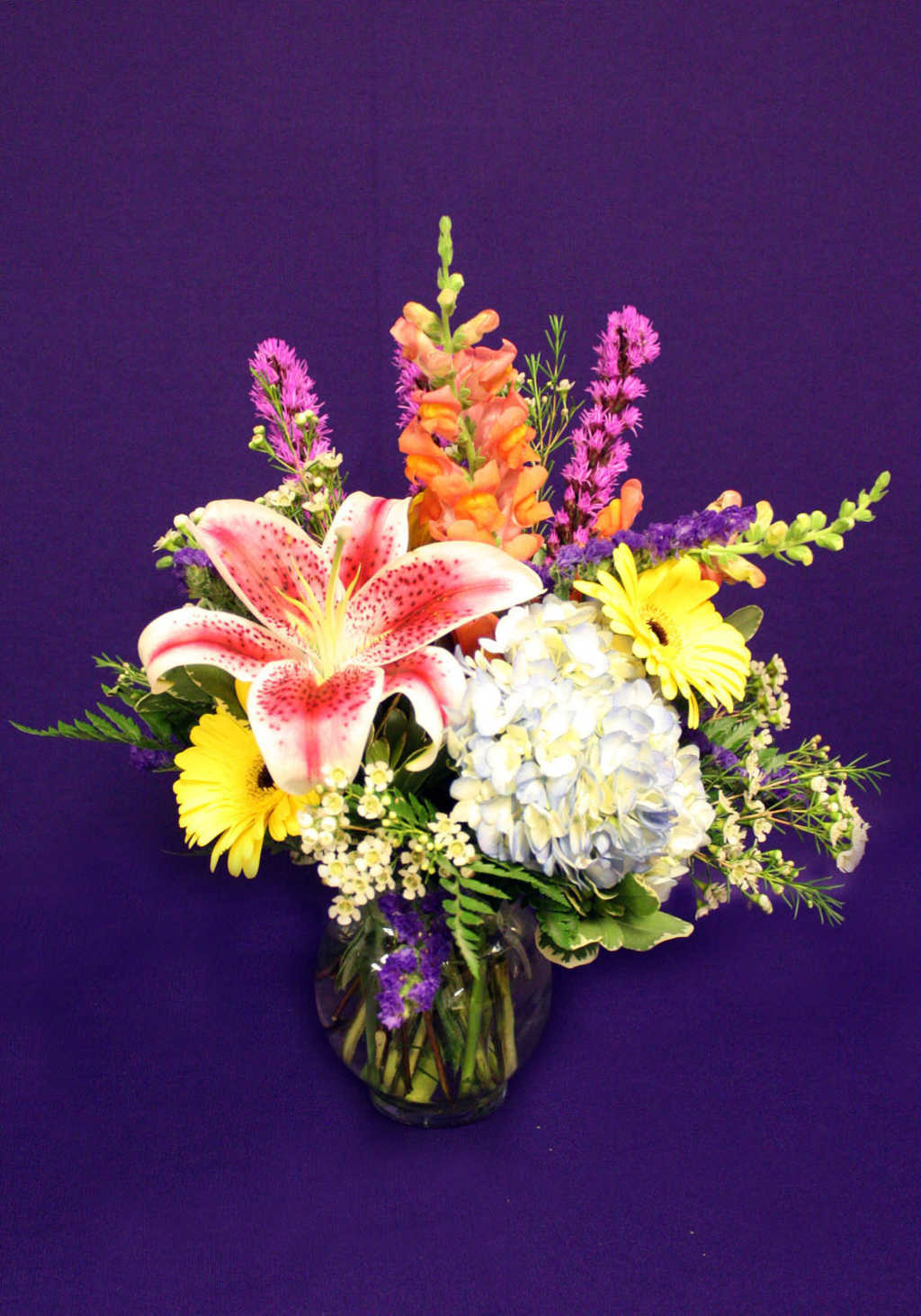 Floral arrangements with lillies, daisies, and delphiniums from Mon General Hospital Gift Shop